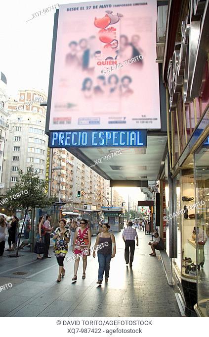 Women walking in Gran Via, Madrid, Spain