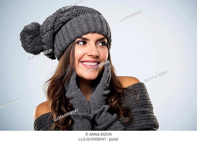 Gorgeous young woman wearing winter clothing looking at copy space Debica, Poland