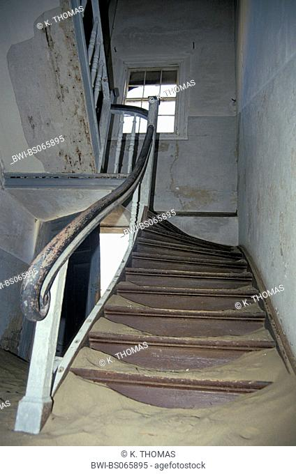 abandoned stairs covered with sand, Namibia, Kolmanskop