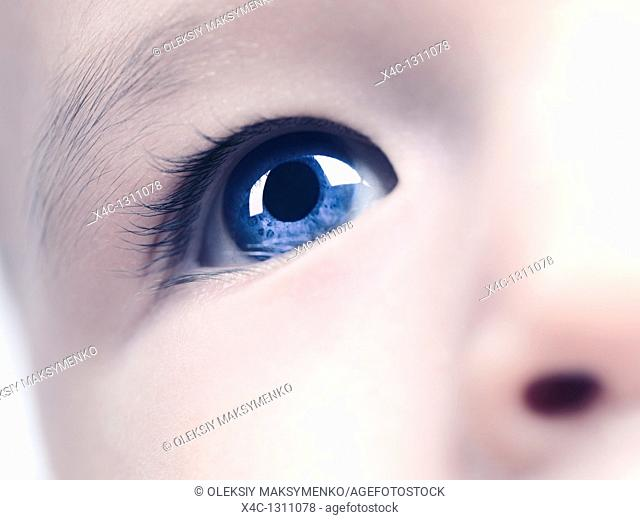 Closeup of a blue eye of a six month old baby boy  Digitally altered