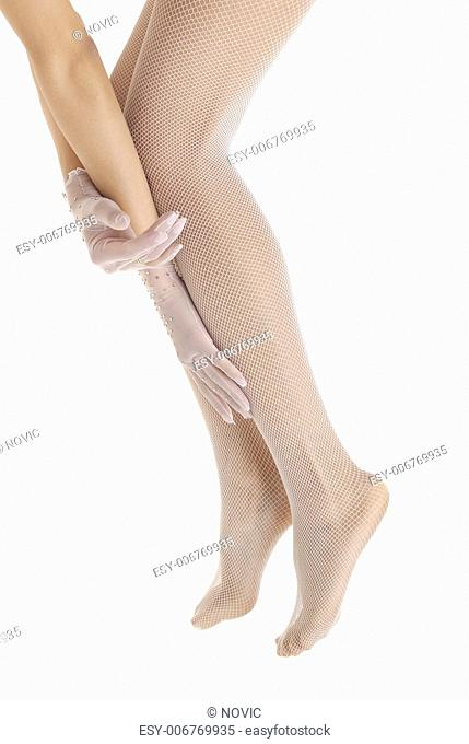 Close-up photo of the hand in gloves and legs in leotards