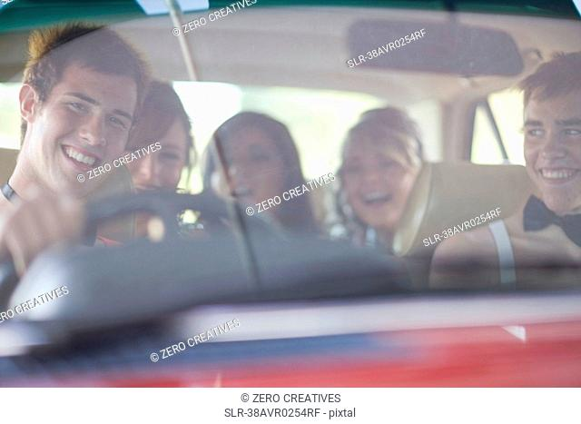 Teenagers driving in formal wear