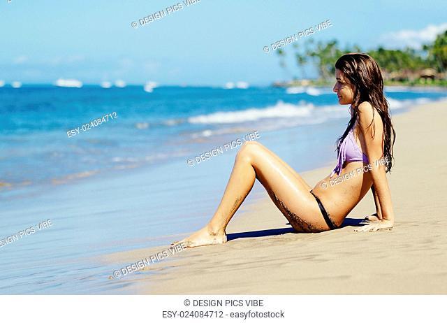 Beautiful Young Woman Enjoying Sunny Day on the Beach