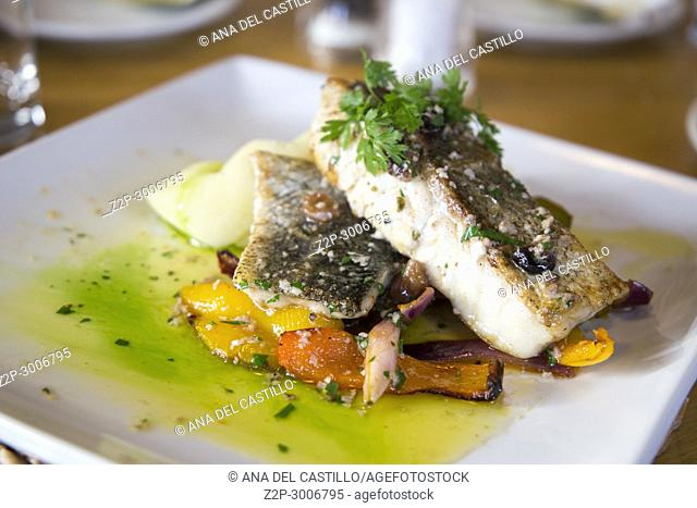 French food Grilled fish with butter and vegetables