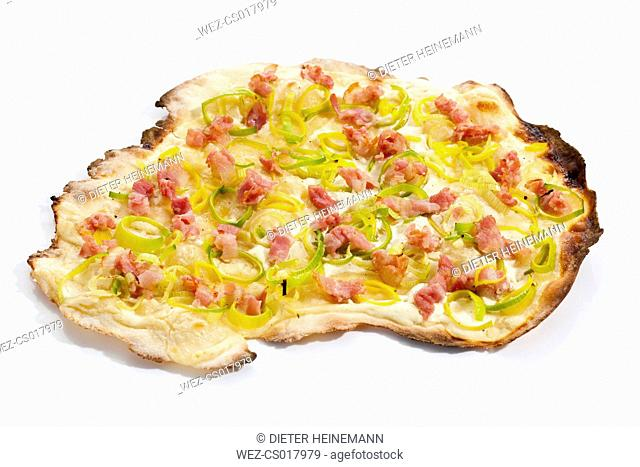 Tarte flambee with bacon and leeks, close up