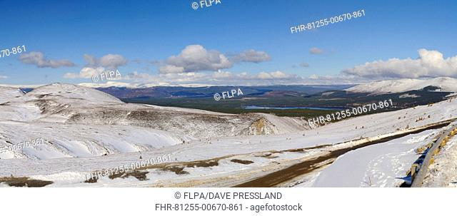 View across snow covered mountain, looking towards Loch Morlich with Aviemore and Monadhliath Mountains in distance, Cairn Gorm, Cairngorms N.P