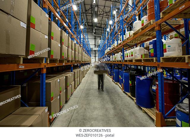 Warehouseman moving in storehouse