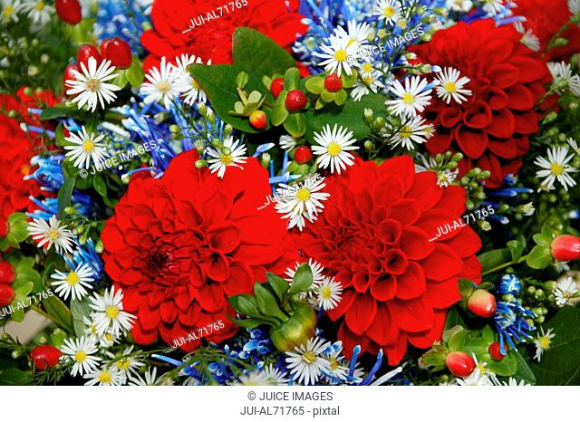 Detail view of a bunch of flowers, including red Dahlias