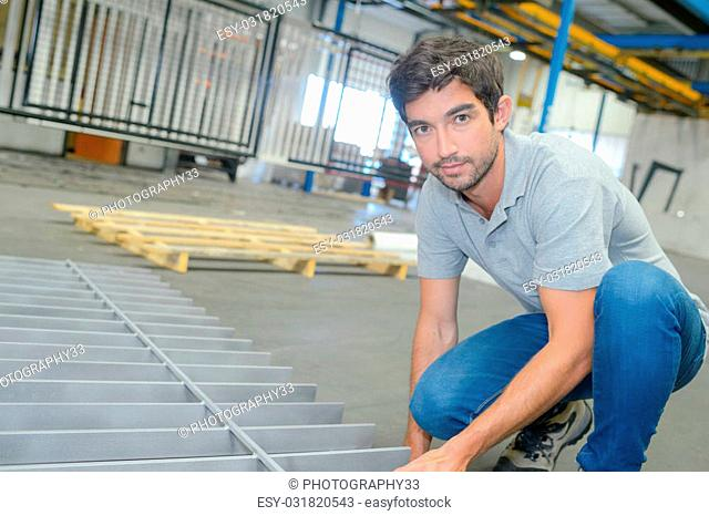 Worker with metal grid