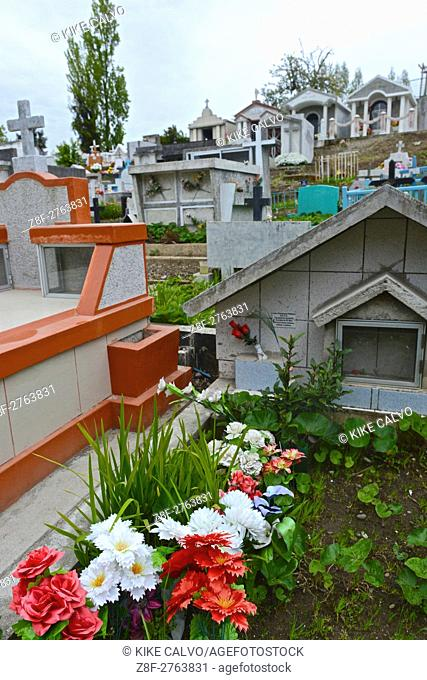 Mausoleums and graves at a graveyard in Chiloe Chile
