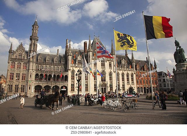 Horse Carriage and flags in front of the Provincial Court- Provincial Government or Grand Palace on the Market Square, Bruges, West Flanders, Belgium, Europe