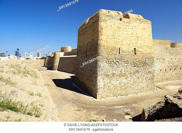 Bahrain Fort dates from 2300 BC Copper and Bronze Ages. Once capital of Dilmun civilization. Looking west to Manama cityscape