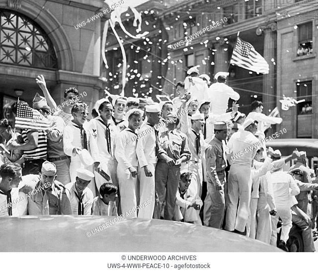 United States: 1945. Sailors and civilians celebrate the end of the war