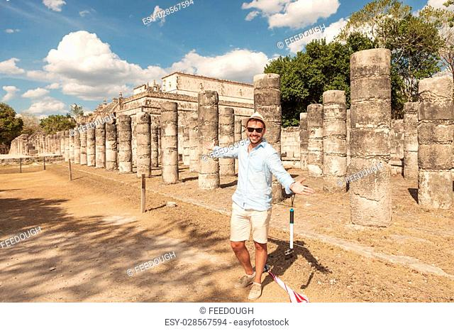 Happy man inviting you to visit the ruins in Tulum, Mexico