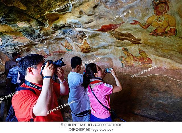 Sri Lanka, Ceylon, North Central Province, Sigiriya Lion Rock fortress, UNESCO world heritage site, cave frescoes of the 5th century representing Apsara and...