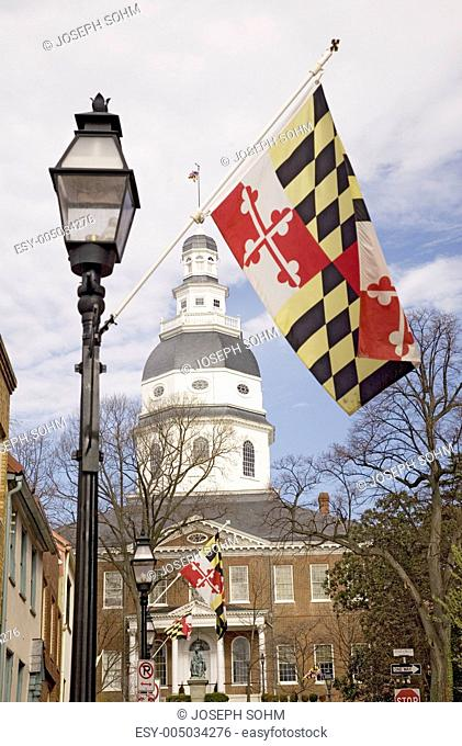 Maryland State Flag and gas lamp in foreground, with Maryland State Capitol dome in background, Annapolis, Maryland
