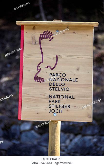 A wooden sign indicating the Stelvio National Park Upper Valtellina Lombardy Italy