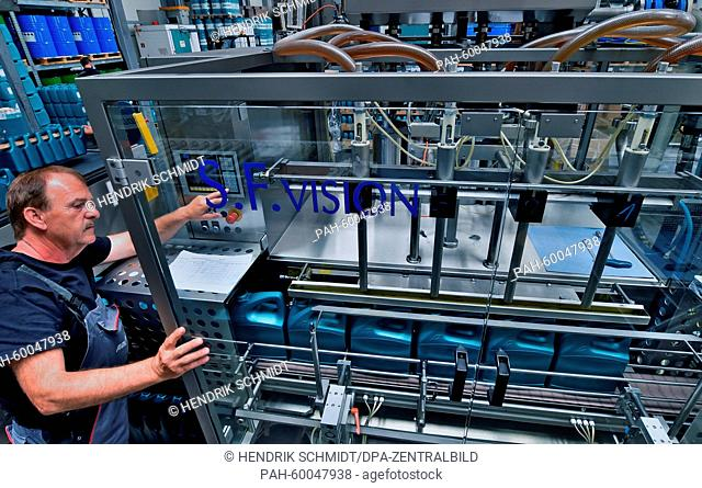 Employee Gerhard Ritter supervises the bottling line for engine oil at Addinol Lube Oil GmbH in Leuna, Germany, 08 July 2015