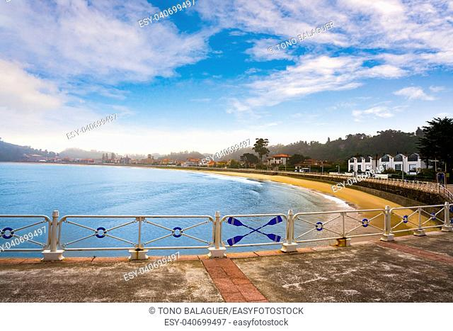Ribadesella beach in Asturias with white railing in Spain