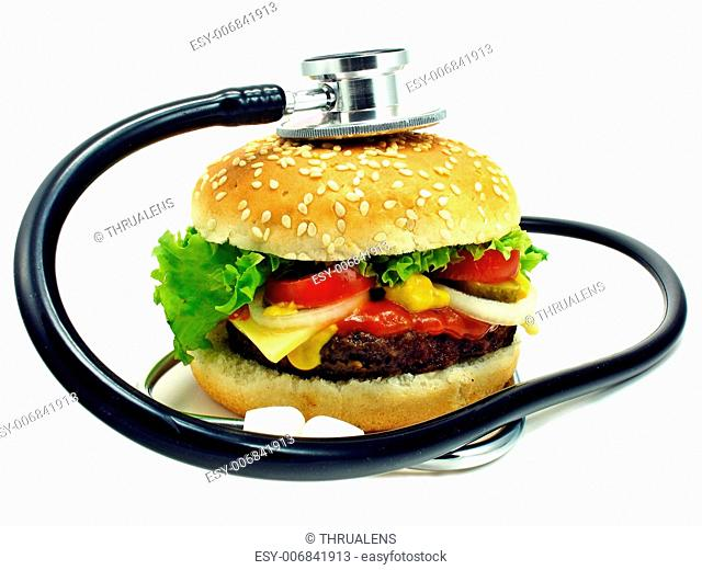 Health concept of cheeseburger & stethoscope