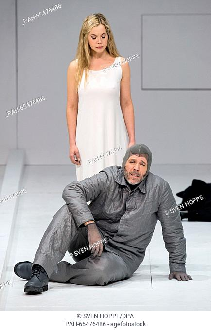 Opera singers Thomas Hampson (front) as Roald Amundsen and Mojca Erdmann as Landlady perform on stage during a rehearsal of the opera 'South Pole' at the...