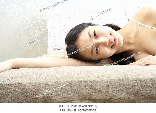 Young Korean Woman on the Bed