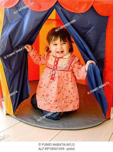 Kid playing in a children tent