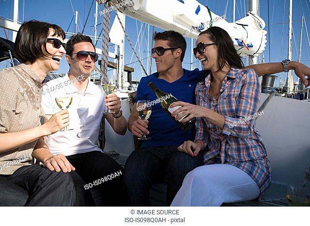 Friends drinking wine on a boat