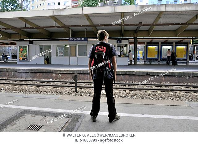 Ten-year-old boy waiting at the train station, Wuppertal, Bergisches Land region, North Rhine-Westphalia, Germany, Europe