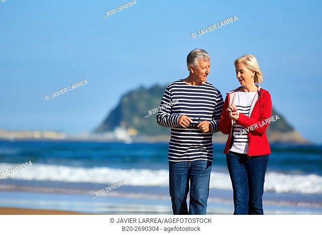 Senior couple, 60-70, Walking on the beach, background Getaria, Zarautz, Gipuzkoa, Basque Country, Spain, Europe