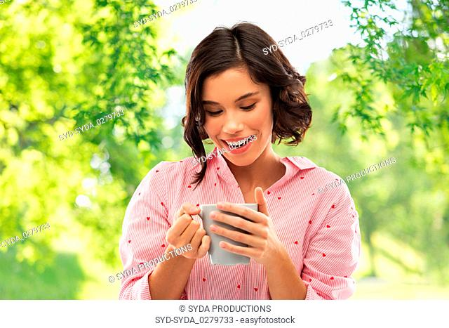 happy young woman in pajama with mug of coffee
