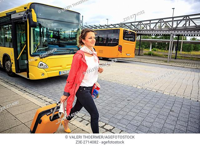 portrait of a young woman at bus and rail station