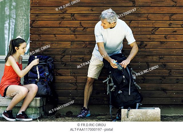 Father and daughter packing bags