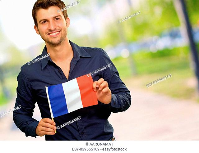 Young Man Holding France Flag, Outdoor