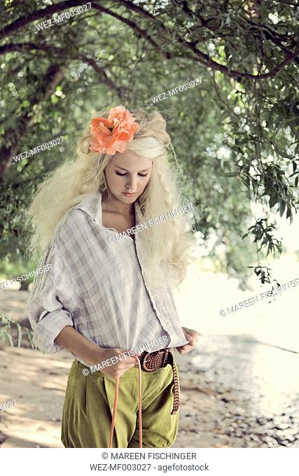 Blond teenage girl on the beach
