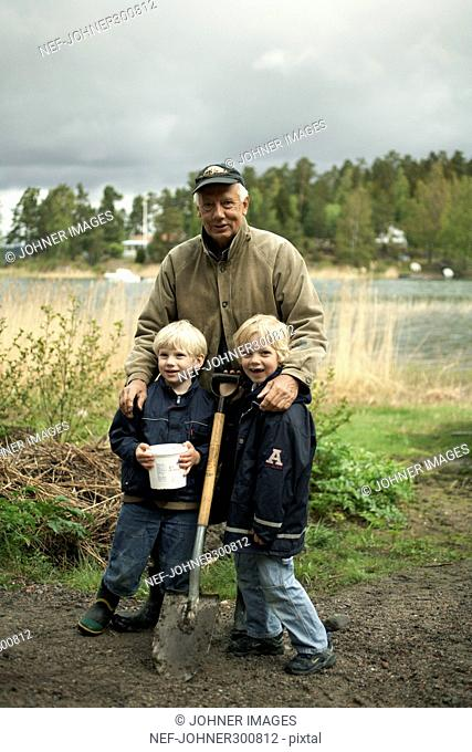 Grandfather with grandchildren on an excursion