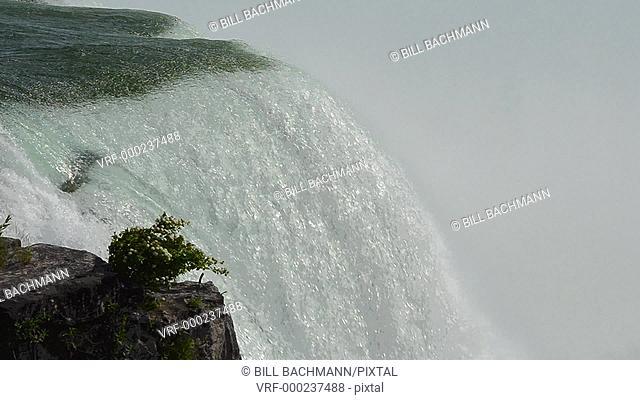 Niagara Falls New York closeup of the water over edge on the American Falls Bridal Falls rushing water