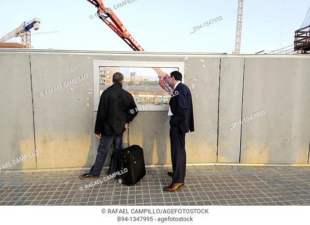Men looking at construction site, Plaça de les Glories, Barcelona, Catalonia, Spain