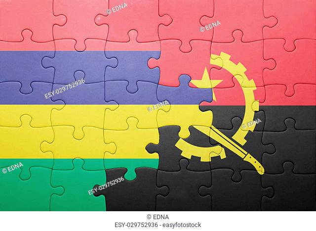 puzzle with the national flag of angola and mauritius . concept