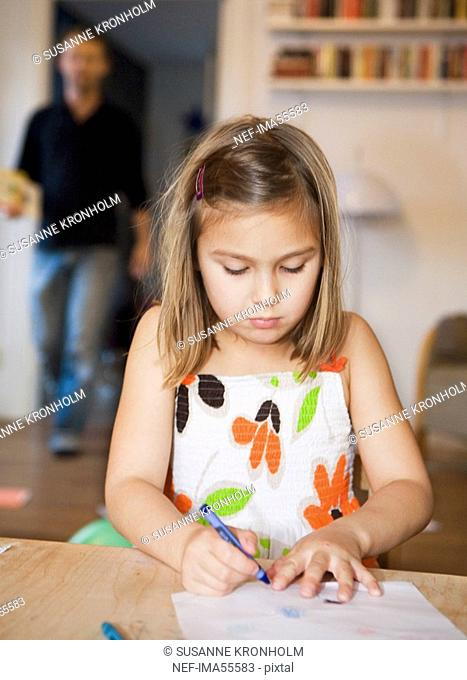 A girl painting on a paper Sweden