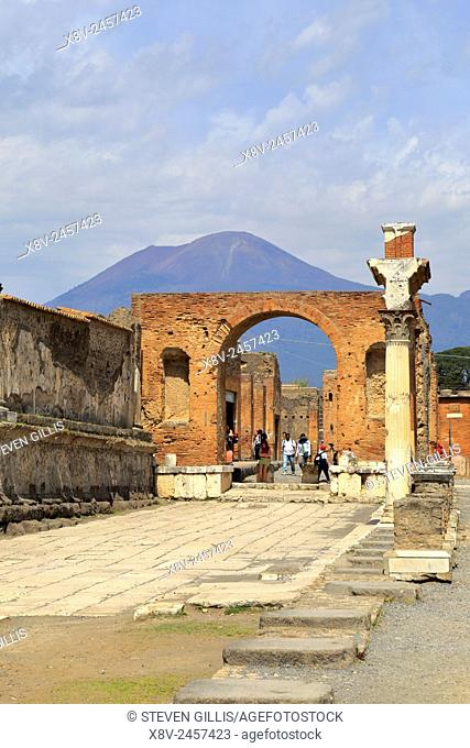 Memorial Arch in honor of Nero with Mount Vesuvius in the distance, Pompeii, Italy