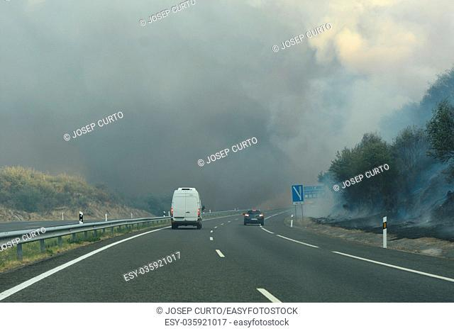 freeway (A 52) cut by a fire near Verin, Galicia, Spain