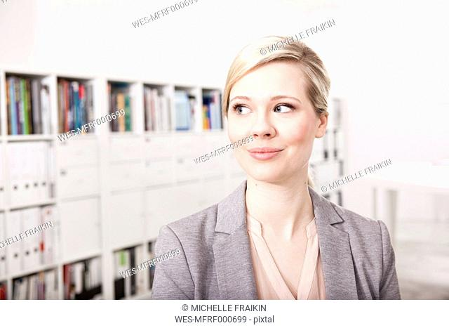 Portrait of blond businesswoman in the office