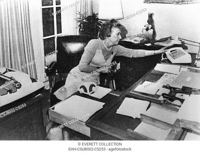 Rosemary Woods, President Nixon's personal secretary, demonstrating the 'Rose Mary Stretch'. She showed photographers how she may have caused the 18 1/2-minute...