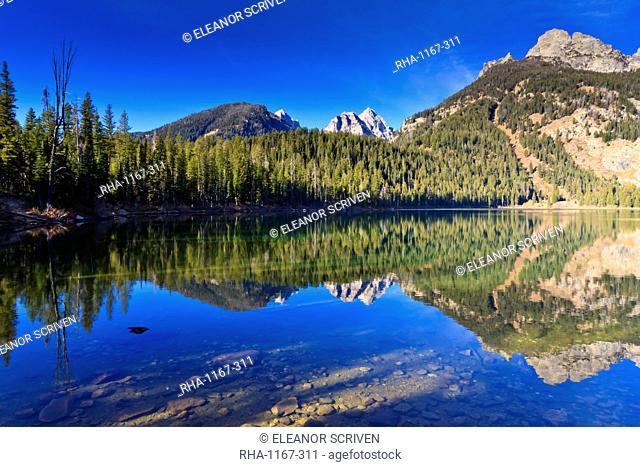 Reflection of the Teton range, Bradley Lake, Grand Teton National Park, Wyoming, United States of America, North America