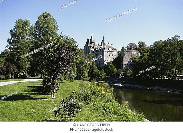 Canal flowing beside castle, Castle Of Durbuy, Belgium