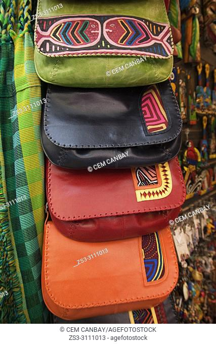 Close-up shot of colorful bags made from leather at the shop in Art And Craft market at the historic center, Bogota, Cundinamarca, Colombia, South America