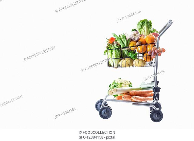 A shopping trolley full of fresh fruit and vegetables