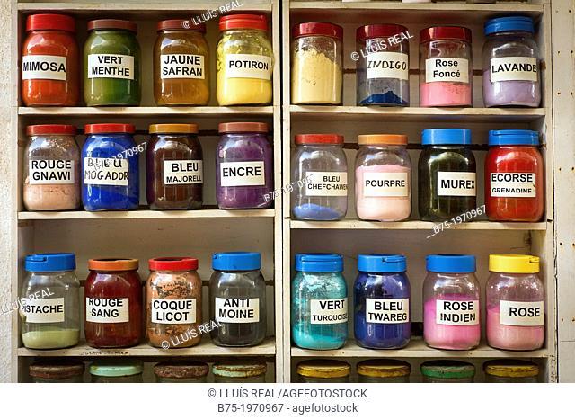 Shelf full of jars of dye colors