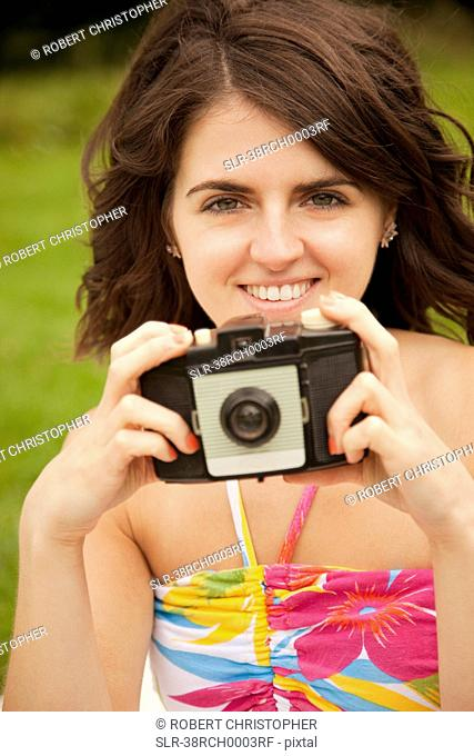 Woman taking pictures in park